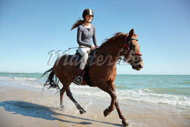 Girl riding horse on beach Stock Photo - Premium Royalty-Freenull, Code: 635-05551108