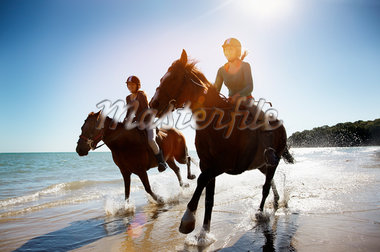Girls riding horses on beach Stock Photo - Premium Royalty-Freenull, Code: 635-05551122
