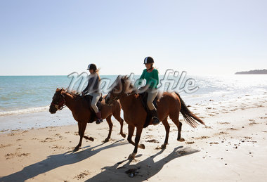 Girls riding horses on beach Stock Photo - Premium Royalty-Freenull, Code: 635-05551134