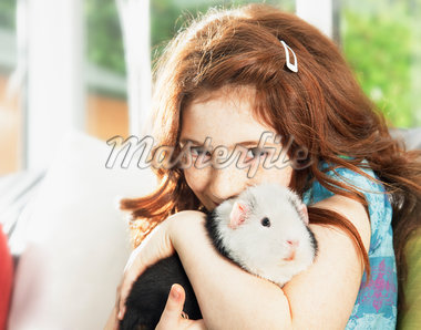 Girl hugging pet hamster Stock Photo - Premium Royalty-Freenull, Code: 635-05551141