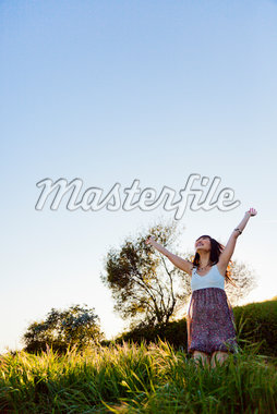 Young Woman with Arms Outstretched Outdoors Stock Photo - Premium Rights-Managed, Artist: ableimages, Code: 822-05554445