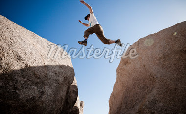 Man Leaping between Two Boulders Stock Photo - Premium Rights-Managed, Artist: ableimages, Code: 822-05554809