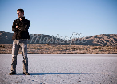 Man Standing with Arms Crossed  in Desert Landscape Stock Photo - Premium Rights-Managed, Artist: ableimages, Code: 822-05554823
