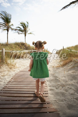 Little Girl Walking on Beach Boardwalk Stock Photo - Premium Rights-Managed, Artist: Michael Alberstat, Code: 700-05560266