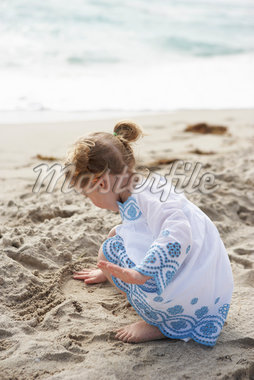 Little Girl Playing in Sand on Beach Stock Photo - Premium Rights-Managed, Artist: Michael Alberstat, Code: 700-05560269