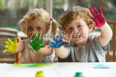 Little girl and boy showing hands covered in paint, portrait Stock Photo - Premium Royalty-Freenull, Code: 632-05604497