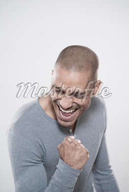 Portrait of Man Cheering Stock Photo - Premium Royalty-Free, Artist: Uwe Umstätter, Code: 600-05609735