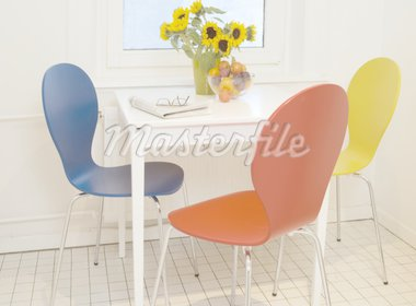 Bunch of flowers on table with three chairs Stock Photo - Premium Royalty-Freenull, Code: 689-05611391
