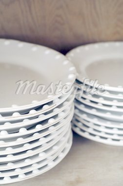 Stack of plates Stock Photo - Premium Royalty-Freenull, Code: 689-05611651
