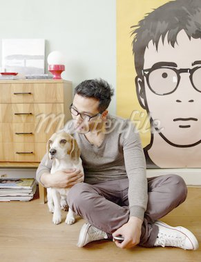 Man caressing dog at home Stock Photo - Premium Royalty-Freenull, Code: 689-05612547