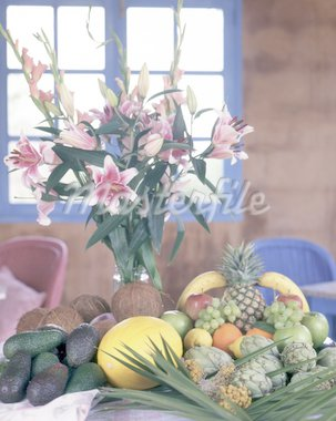 Tropical fruit and bunch of flowers Stock Photo - Premium Royalty-Freenull, Code: 689-05612641