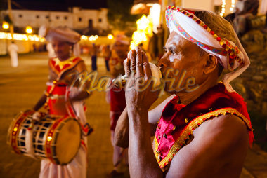 Man Playing Conch Shell Trumpet, Esala Perehera Festival, Kandy, Sri Lanka Stock Photo - Premium Rights-Managed, Artist: R. Ian Lloyd, Code: 700-05642316