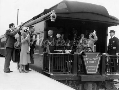 1930s FAMILY WITH GRANDPARENTS & CONDUCTOR ON BROADWAY LIMITED OBSERVATION CAR TRAIN PLATFORM WAVING GOODBYE & FAREWELL Stock Photo - Premium Rights-Managed, Artist: ClassicStock, Code: 846-05648088