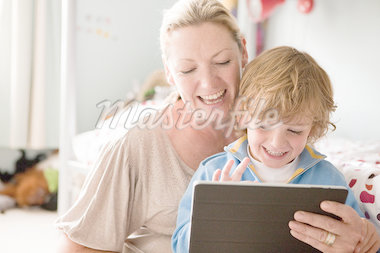 Mother using a digital tablet with her son Stock Photo - Premium Royalty-Freenull, Code: 614-05650621