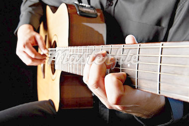 Close up of person playing classical guitar Stock Photo - Premium Royalty-Freenull, Code: 614-05650715