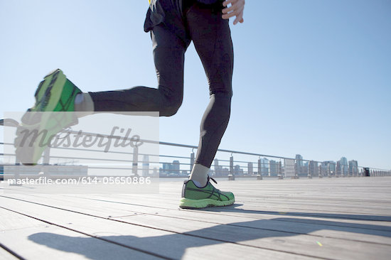 View of an athlete's legs running across walkway Stock Photo - Premium Royalty-Freenull, Code: 614-05650886