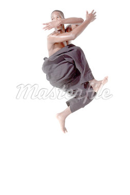 Dancer in mid air pose Stock Photo - Premium Royalty-Freenull, Code: 614-05650897