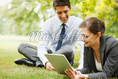 Business people using digital tablet together outdoors Stock Photo - Premium Royalty-Freenull, Code: 635-05651477