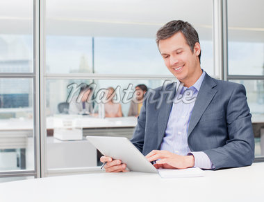 Businessman using digital tablet in office Stock Photo - Premium Royalty-Freenull, Code: 635-05651539
