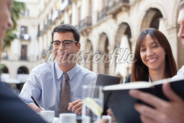 Business people working together in sidewalk cafe Stock Photo - Premium Royalty-Freenull, Code: 635-05651623