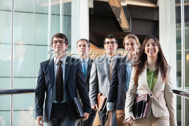 Business people walking together Stock Photo - Premium Royalty-Freenull, Code: 635-05651660