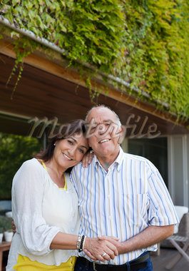Couple hugging outdoors Stock Photo - Premium Royalty-Freenull, Code: 635-05651725