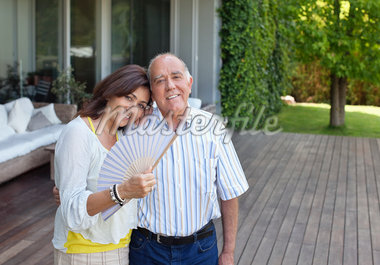 Smiling couple standing on patio together Stock Photo - Premium Royalty-Freenull, Code: 635-05651781