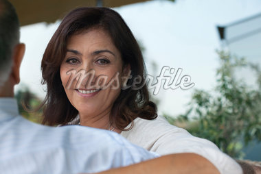 Woman hugging husband outdoors Stock Photo - Premium Royalty-Freenull, Code: 635-05651789