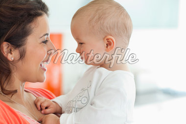 Smiling mother holding baby Stock Photo - Premium Royalty-Freenull, Code: 635-05652217