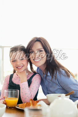 Mother and daughter eating breakfast together Stock Photo - Premium Royalty-Freenull, Code: 635-05652277