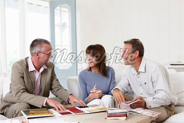 Interior designer showing samples to customers Stock Photo - Premium Royalty-Freenull, Code: 635-05652323