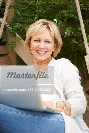Woman using laptop outdoors Stock Photo - Premium Royalty-Freenull, Code: 635-05652352