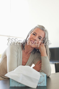 Woman leaning on hand with tissue in foreground, Stock Photo - Premium Royalty-Freenull, Code: 635-05652391