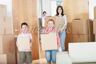 Family carrying boxes into new home Stock Photo - Premium Royalty-Freenull, Code: 635-05652433