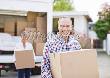 Couple unloading boxes from moving van Stock Photo - Premium Royalty-Freenull, Code: 635-05652435