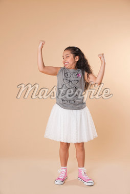 Portrait of Girl Flexing Arms Stock Photo - Premium Royalty-Free, Artist: Uwe Umstätter, Code: 600-05653068