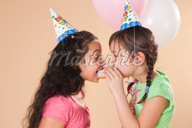Portrait of Girls Eating Doughnut Stock Photo - Premium Royalty-Free, Artist: Uwe Umstätter, Code: 600-05653080