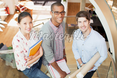 Portrait of smiling business people on stairs in office Stock Photo - Premium Royalty-Freenull, Code: 635-05655978