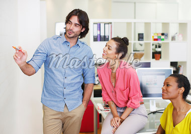 Business people at whiteboard in office Stock Photo - Premium Royalty-Freenull, Code: 635-05655990