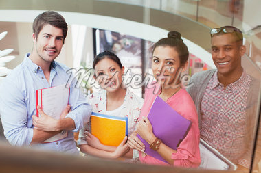Portrait of smiling business people with folders Stock Photo - Premium Royalty-Freenull, Code: 635-05656068