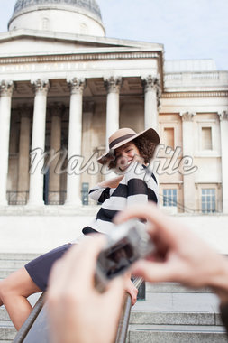 Man taking photograph of woman posing in front of London building Stock Photo - Premium Royalty-Freenull, Code: 635-05656302