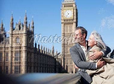 Happy couple hugging in front of Big Ben clocktower in London Stock Photo - Premium Royalty-Freenull, Code: 635-05656303