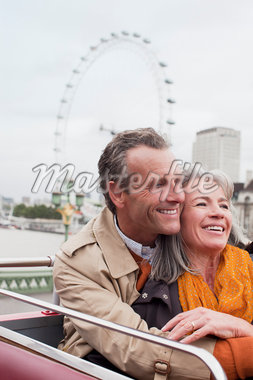 Smiling senior couple on double decker bus in London Stock Photo - Premium Royalty-Freenull, Code: 635-05656399