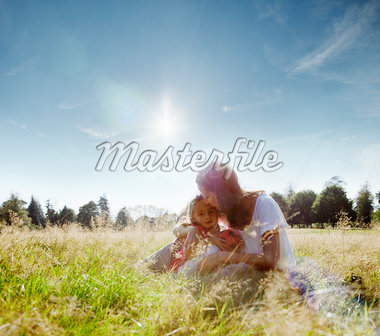 Mother kissing daughter's forehead in rural field Stock Photo - Premium Royalty-Freenull, Code: 635-05656510