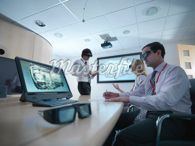 Scientists wearing 3D glasses in lab Stock Photo - Premium Royalty-Freenull, Code: 649-05658043