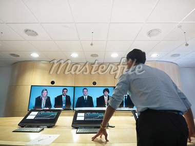 Business people having video conference Stock Photo - Premium Royalty-Freenull, Code: 649-05658051