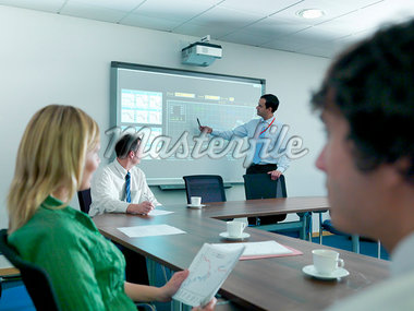 Businessman using projection in meeting Stock Photo - Premium Royalty-Freenull, Code: 649-05658057