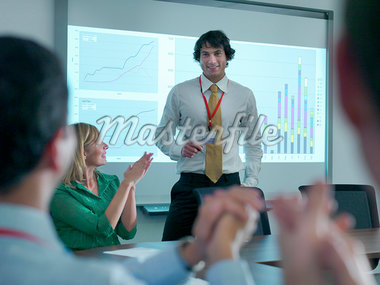 Business people applauding colleague Stock Photo - Premium Royalty-Freenull, Code: 649-05658059
