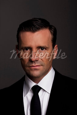 Close up of businessman's frowning face Stock Photo - Premium Royalty-Freenull, Code: 649-05658209