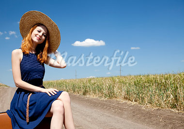 Lonely girl with suitcase at country road. Stock Photo - Royalty-Free, Artist: massonforstock                , Code: 400-05663692